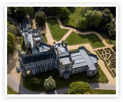 Ariel view of the Castle set in green lawns with winding gravel paths and Parterre