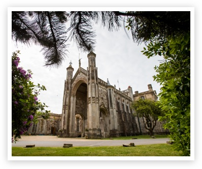 View of North Porch of Highcliffe Castle framed by foliage