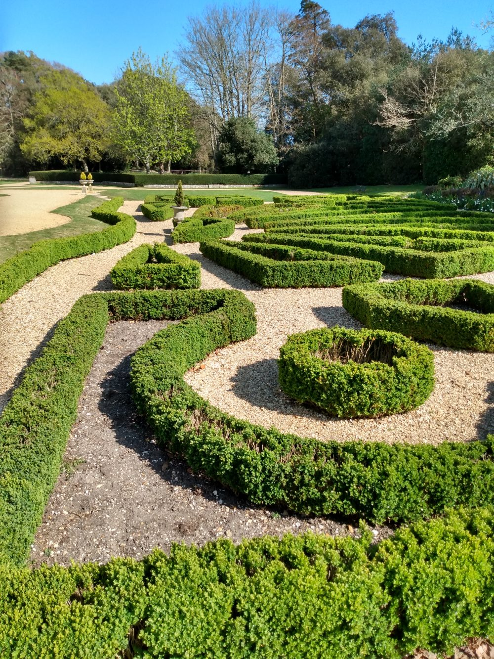 The Parterre with neat box shrub patterns and gravel in between