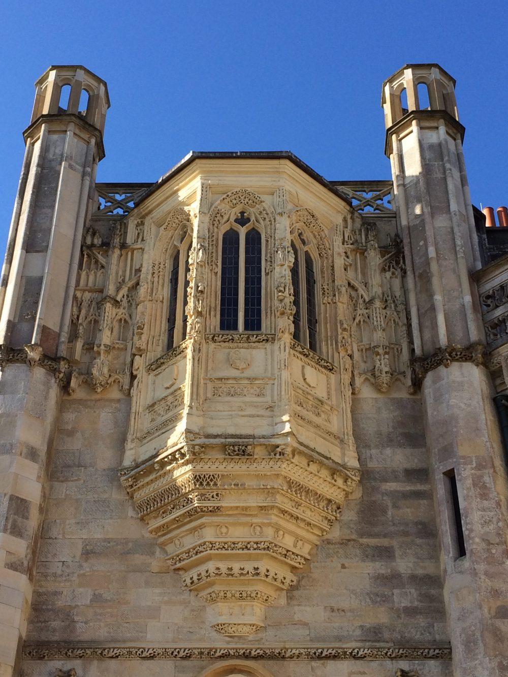 Carved and decorative stone Oriel window under deep blue sky