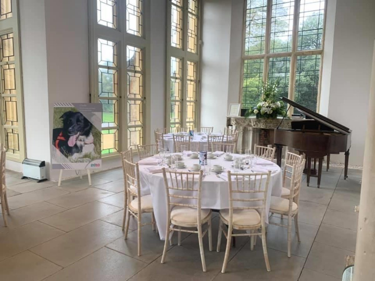 Highcliffe Castle Wintergarden with round tables ready for a function