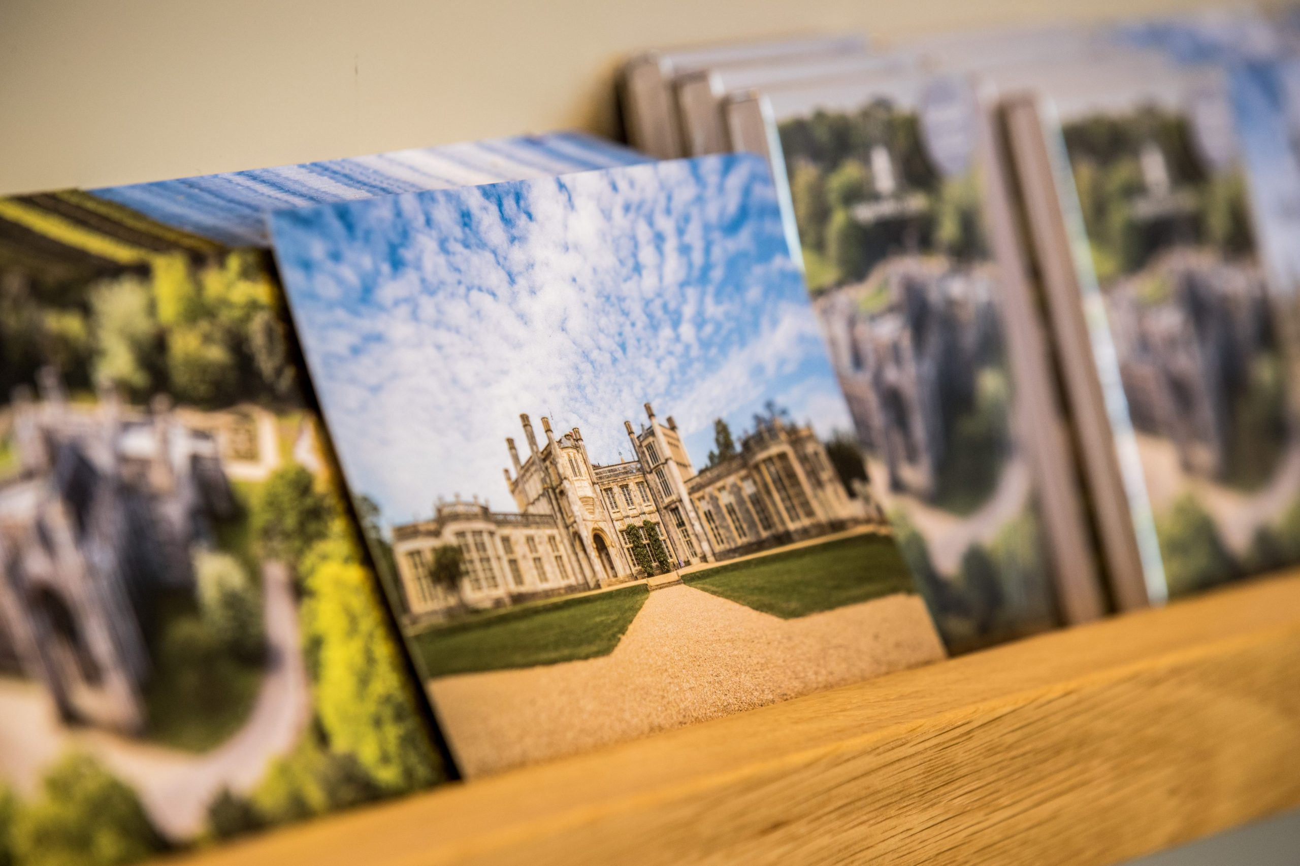 Picture of Highcliffe Castle postcard with blue skies and lush green grass