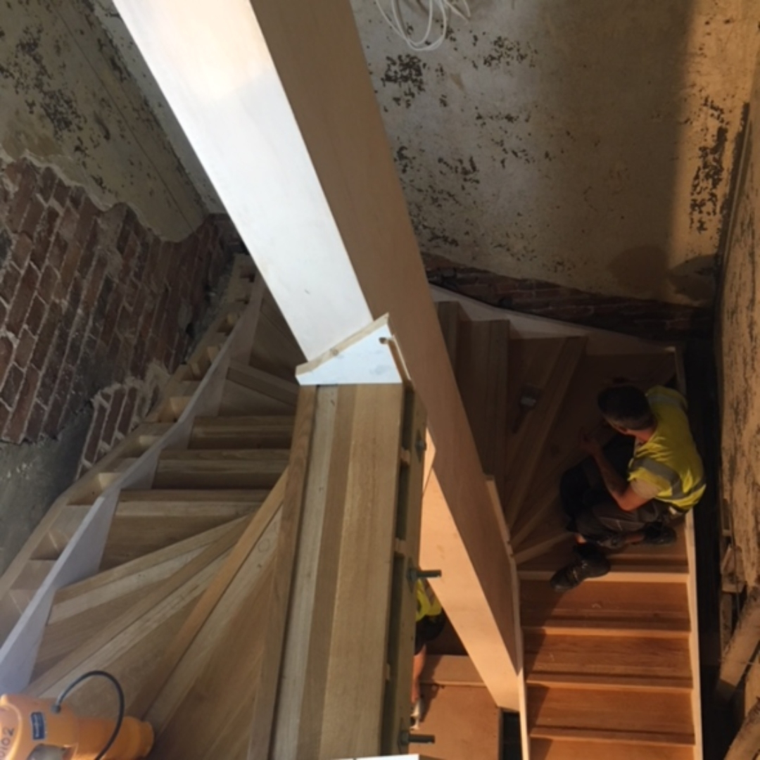 Workman working on restoring the old servants staircase