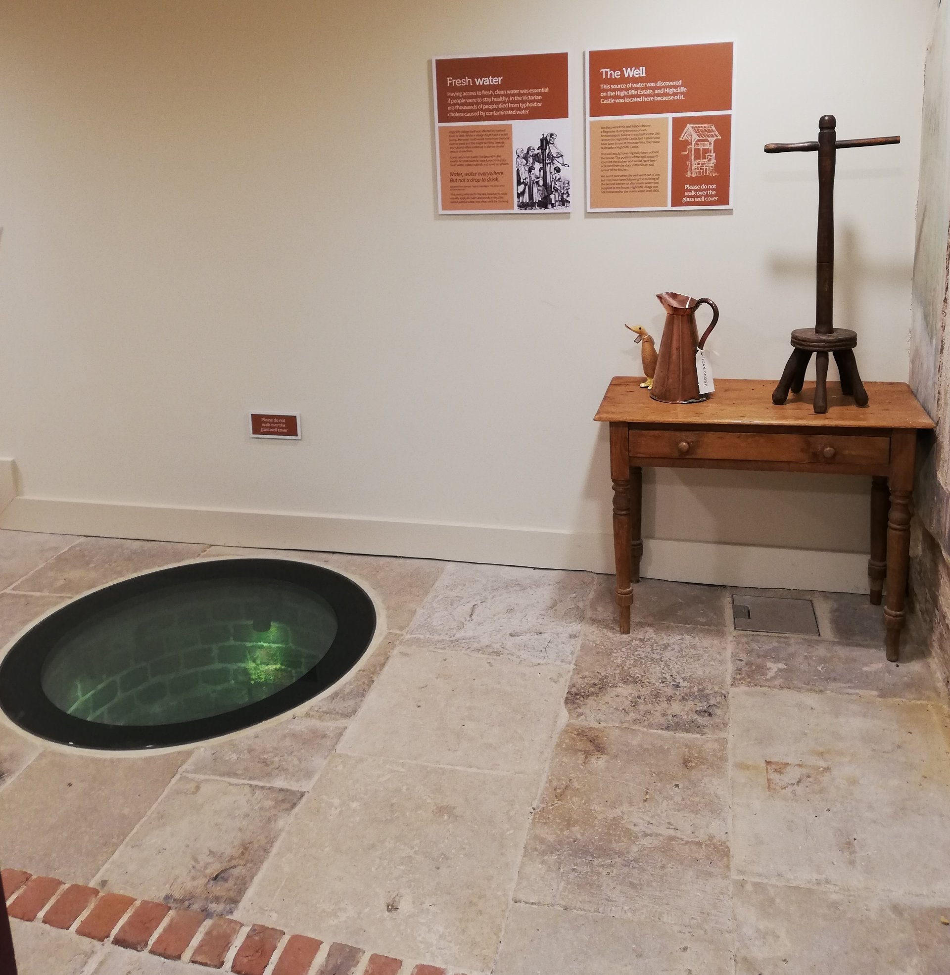 Spot the Duck - Beatrix hiding by the well, next to a copper water jug at Highcliffe Castle