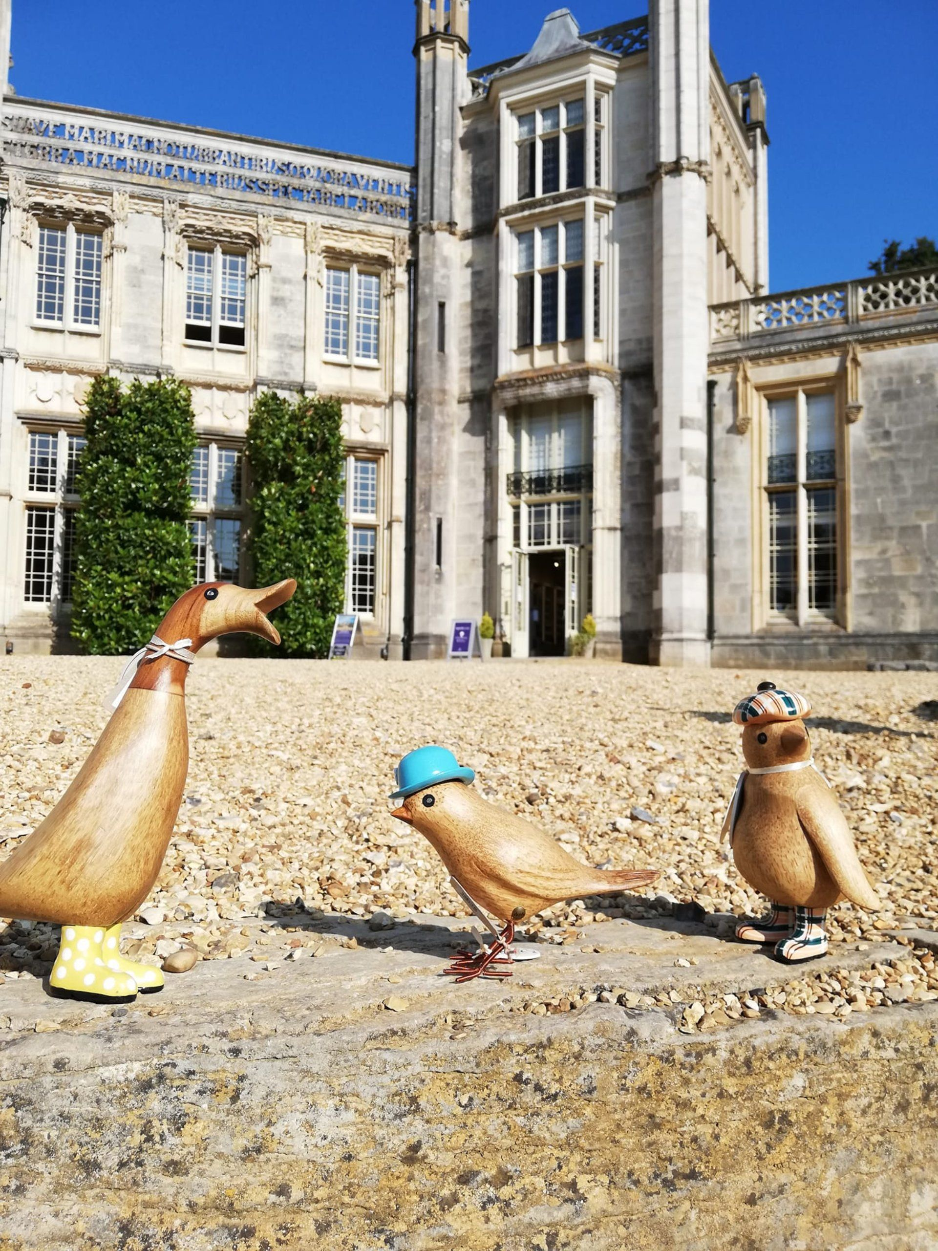 Highcliffe Castle Spot the Duck Trio standing in front of the Castle entrance