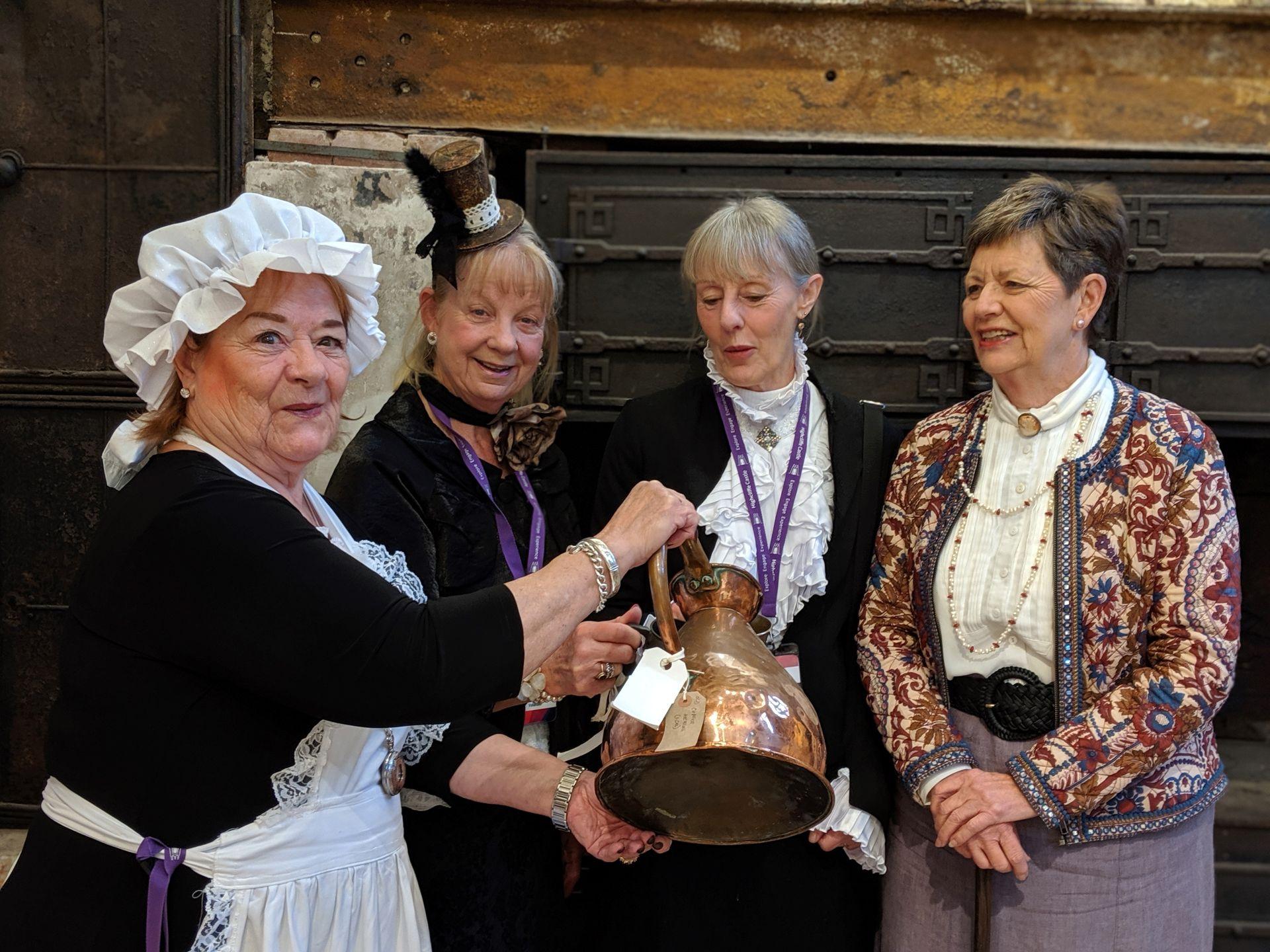 Volunteers in costumed dress representing volunteering at Highcliffe Castle